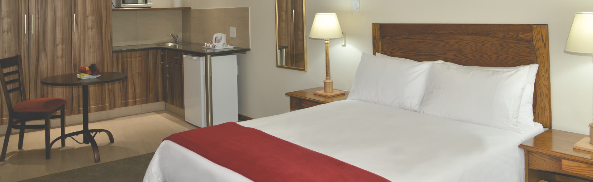 Double bed and kitchenette Park Hotel room