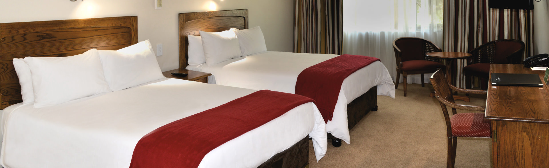 Park Hotel two double in room beds for Deluxe Family Sutie