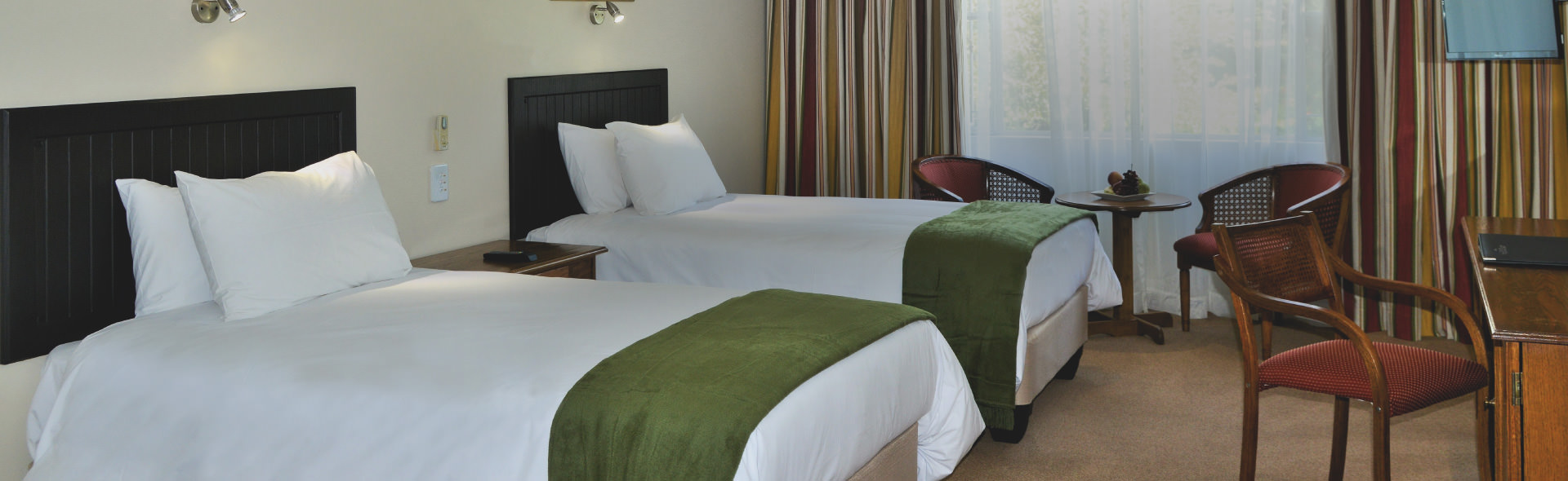 Park Hotel's Deluxe Twin room with two three quarter beds
