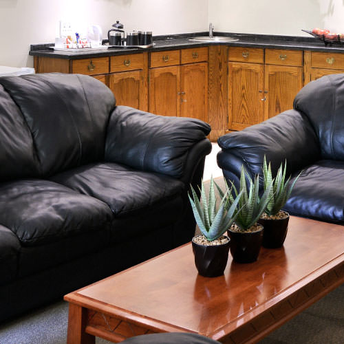 The Park Hotel's Executive Suite comfortable leather couches